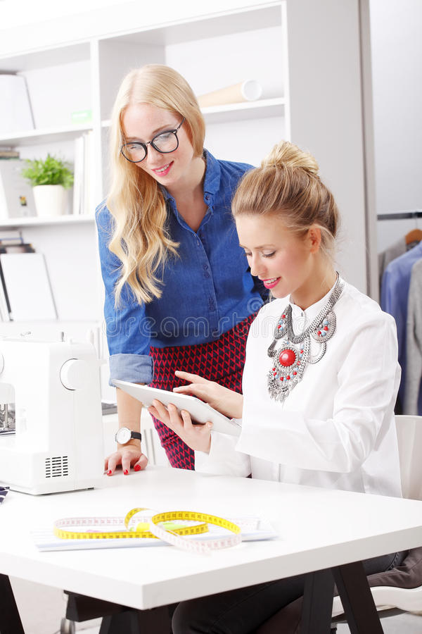 Young fashion designers at work stock photos