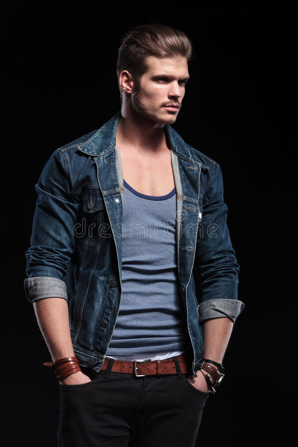Download Young Fashion Man In Casual Jeans Clothes Looking Away Stock Photo - Image: 39546290