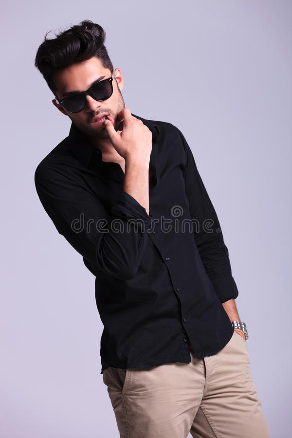 Free Young Fashion Man Touches Lower Lip Stock Photos - 33657553
