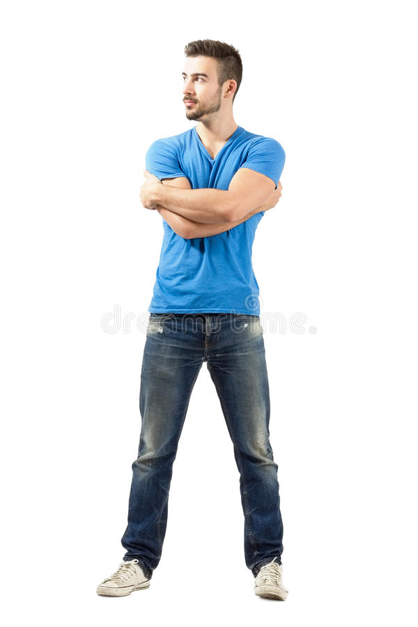 Young fashion model with arms wrapped around himself looking up. Full body length isolated over white background stock image