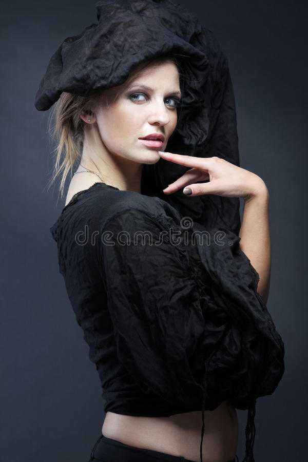 Download Young Fashion Model Posing On Dark Background. Stock Image - Image: 18229487