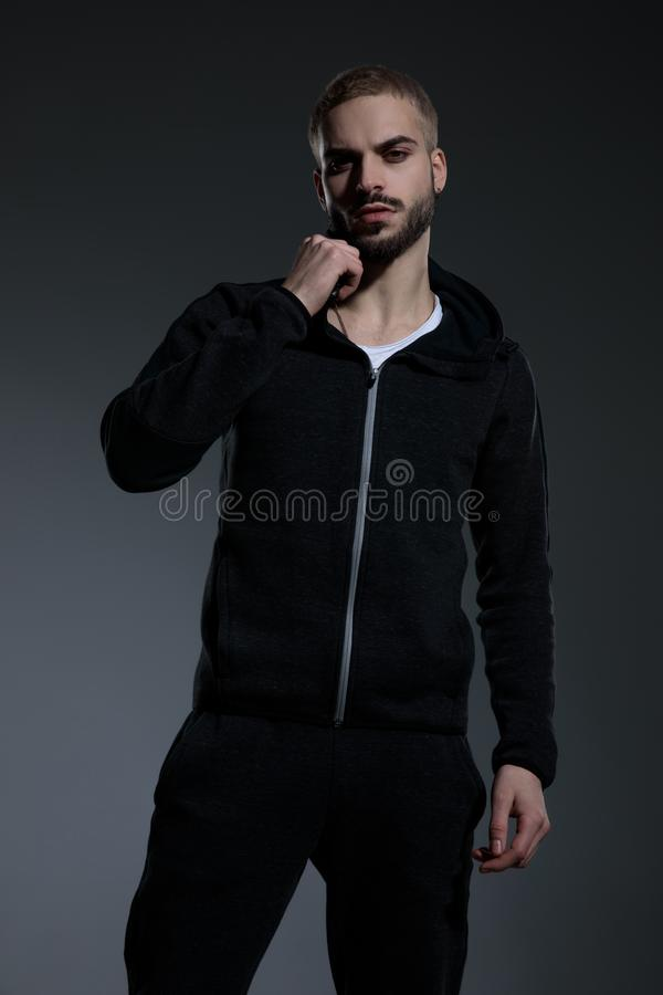 Young fashion model wearing gym suit and holding hands stock image