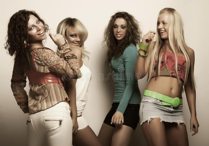 Young fashion models in colorful dress royalty free stock photos
