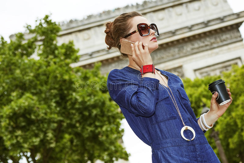Young fashion-monger talking on mobile phone in Paris, France stock image