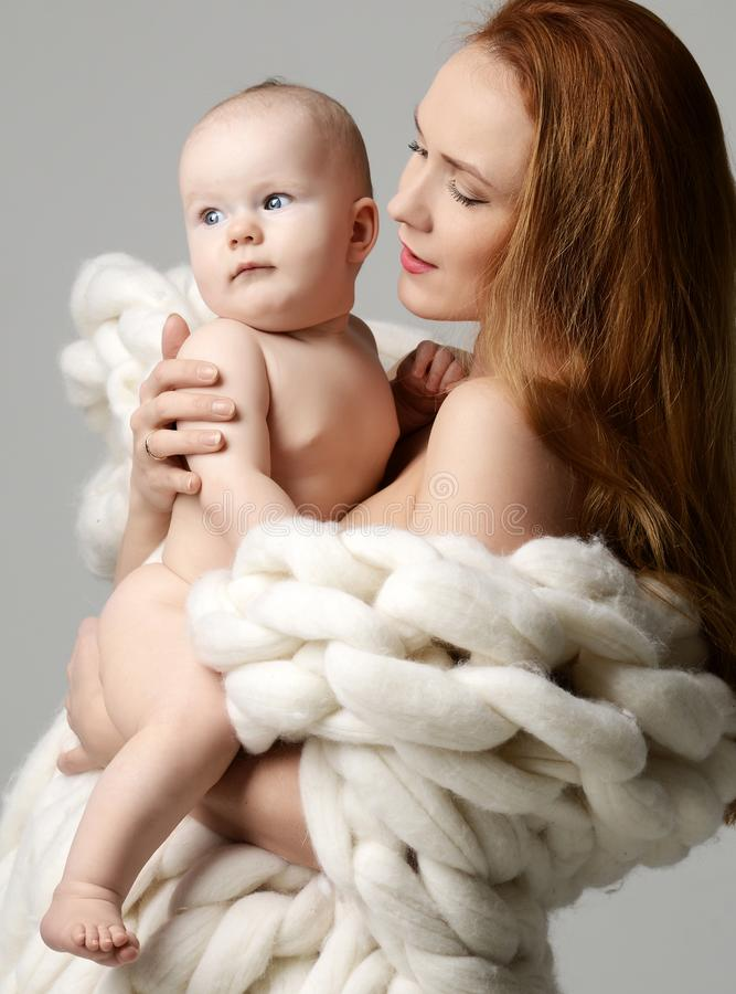 Young fashion mother woman standing and holding infant child baby girl standing. Young fashion mother women standing and holding infant child baby girl standing royalty free stock images