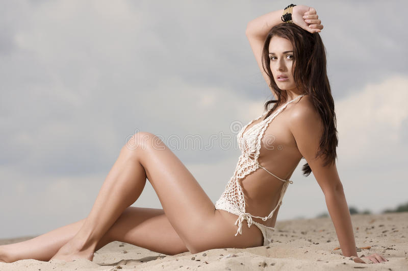 Young fashion pretty woman on the beach stock photos