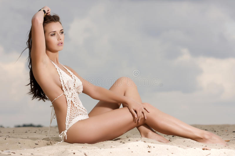 Young fashion pretty woman on the beach stock images