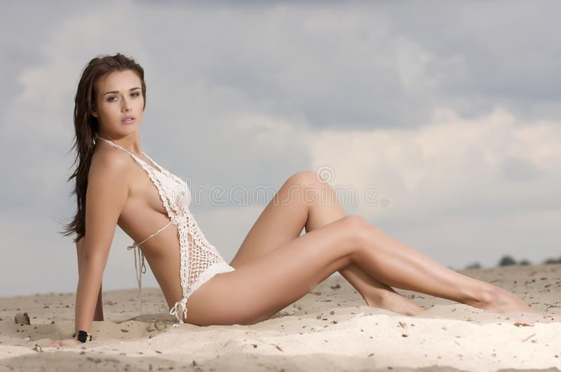 Young fashion pretty woman on the beach stock photography