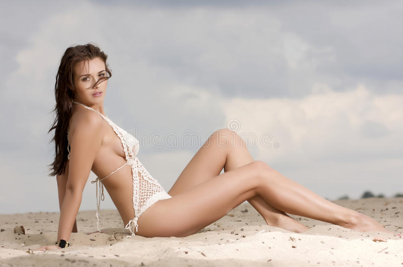 Young fashion pretty woman on the beach royalty free stock photos