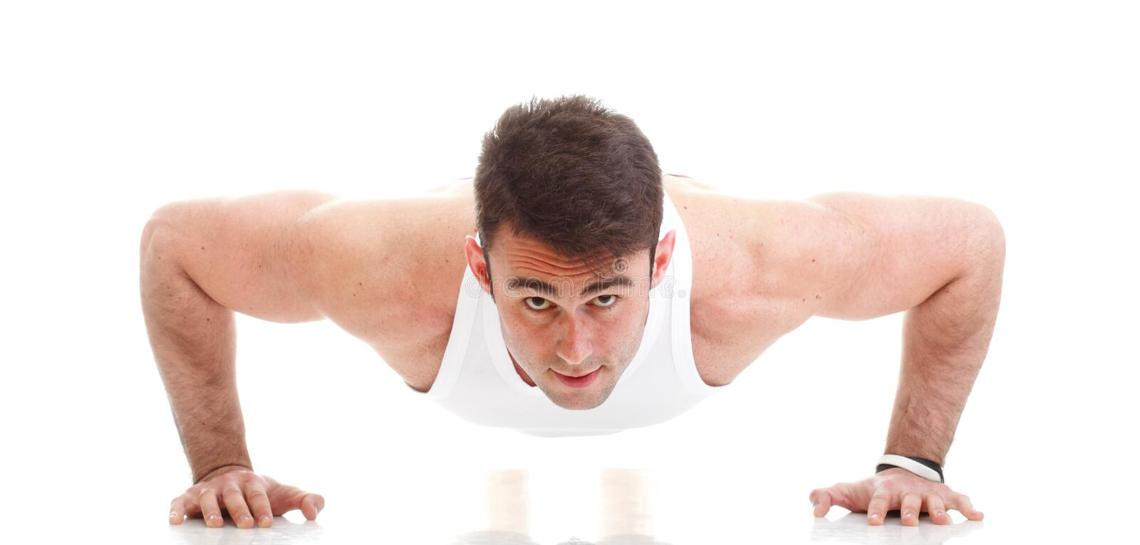 Young fashion sport man fitness muscle model guy exercise isolat. Young fashion sport man, fitness muscle model guy making push ups exercise white background royalty free stock image