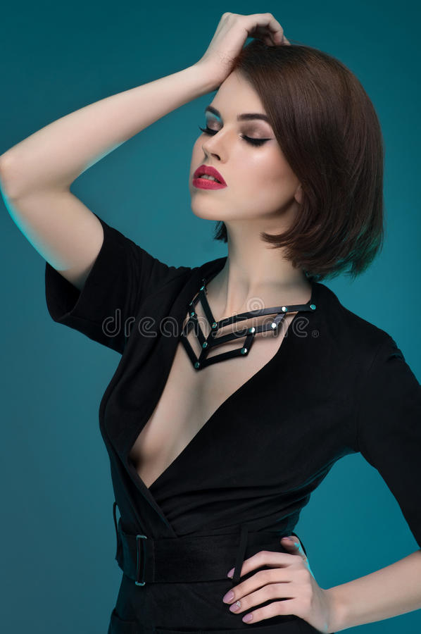 Young fashion woman posing in leather harness royalty free stock photos