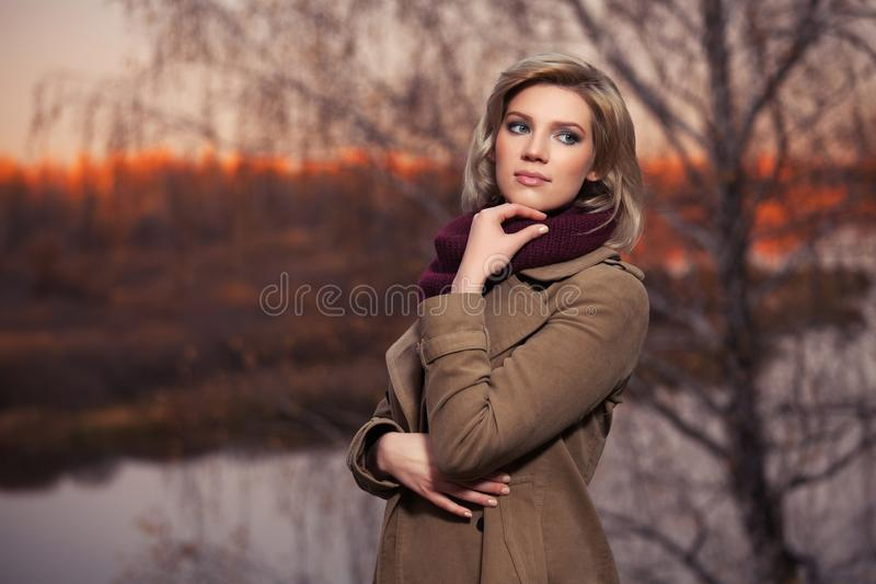 Young fashion woman walking in autumn park royalty free stock photo