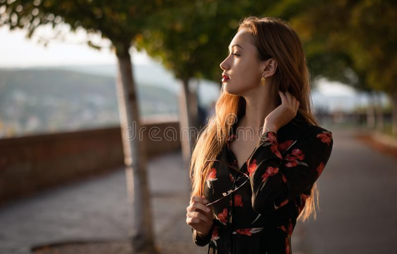 Young and fashionable brunette. stock photo