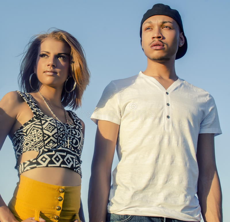Young fashionable man and woman