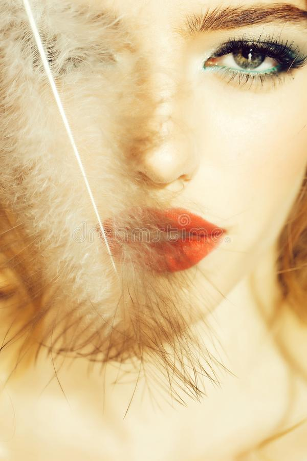Pretty woman with feather closeup stock photo