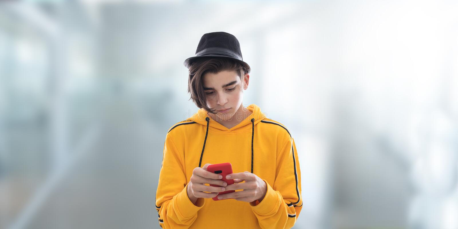 Teen fashioned mobile phone royalty free stock photography