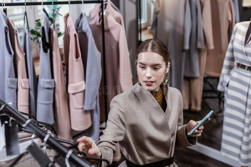 Stylish woman choosing clothes for her friend stock photos