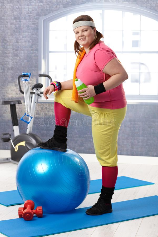 Young fat woman at the gym stock image