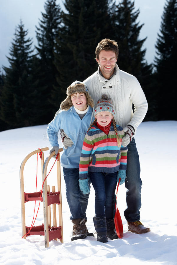 Free Young Father And Children In Snow With Sled Stock Image - 20118981