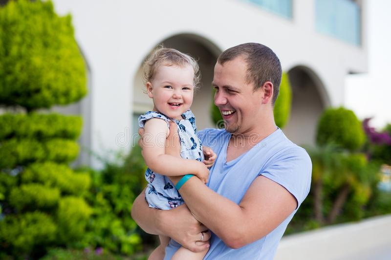 Young father with cute happy daughter stock image