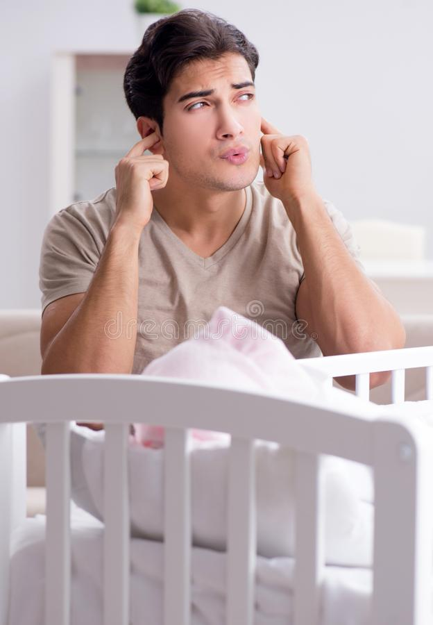 The young father dad frustrated at crying baby stock image