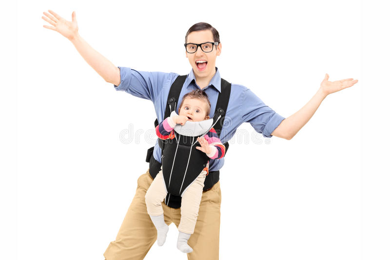 Young father dancing and carrying his baby daughter royalty free stock photo
