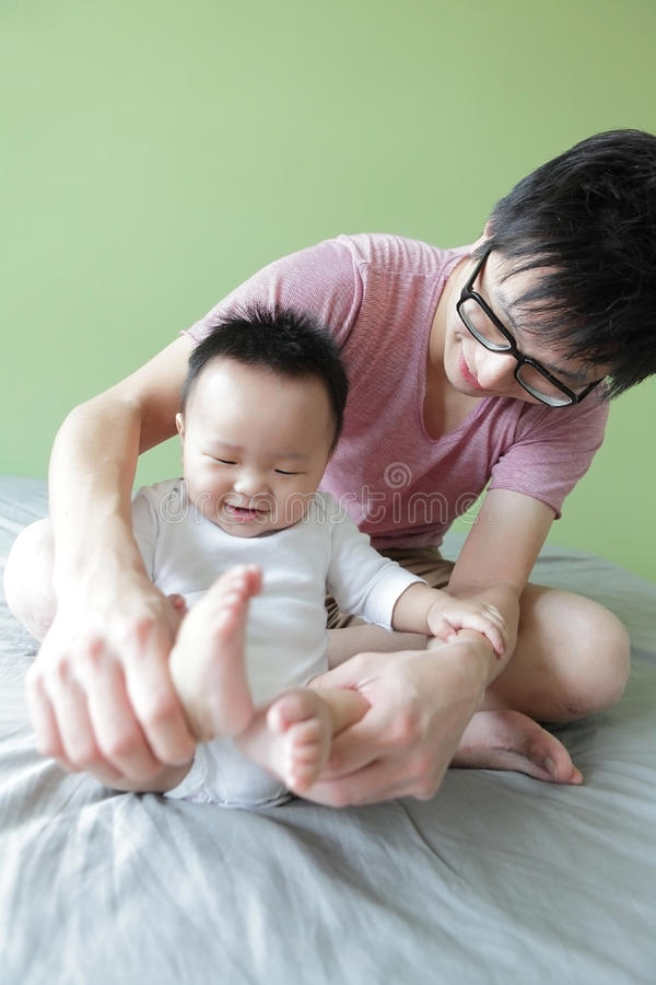Download Young Father Happy Play With His Baby Stock Image - Image of face, chinese: 23170957