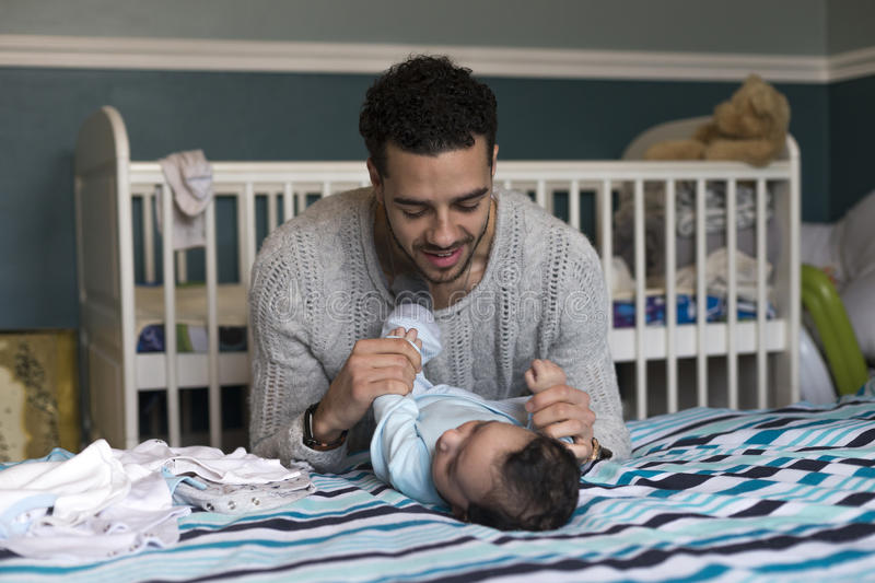 Young father having playtime with son stock photo