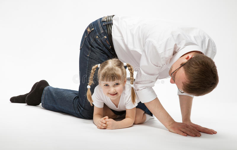 Young father and his happy little daugther playing stock photo