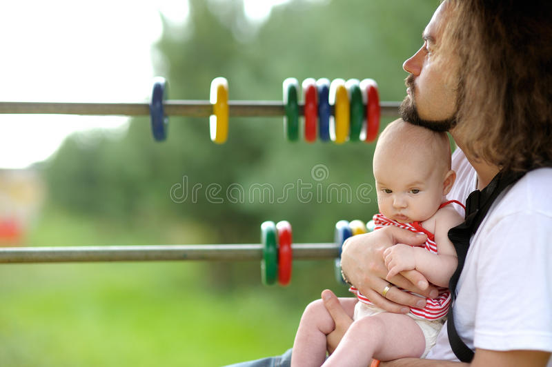 Young father and his little baby girl stock photos