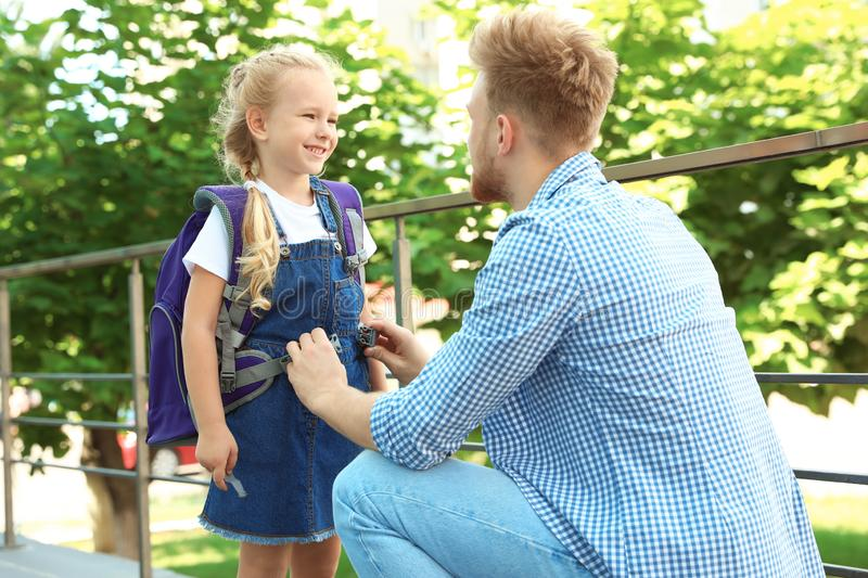 Young father and his little child on their way to school royalty free stock photos