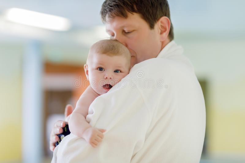 Young father and his little cute newborn baby daughter together in spa hotel. stock photos