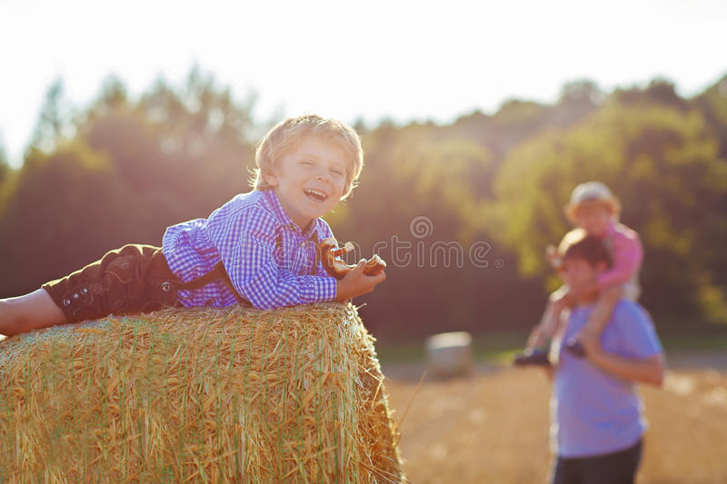 Download Young Father And His Little Son Having Fun On Yellow Hay Field I Stock Image - Image: 67080805
