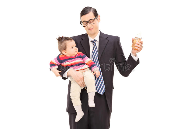 Young father holding his daughter and bottle of juice royalty free stock photos