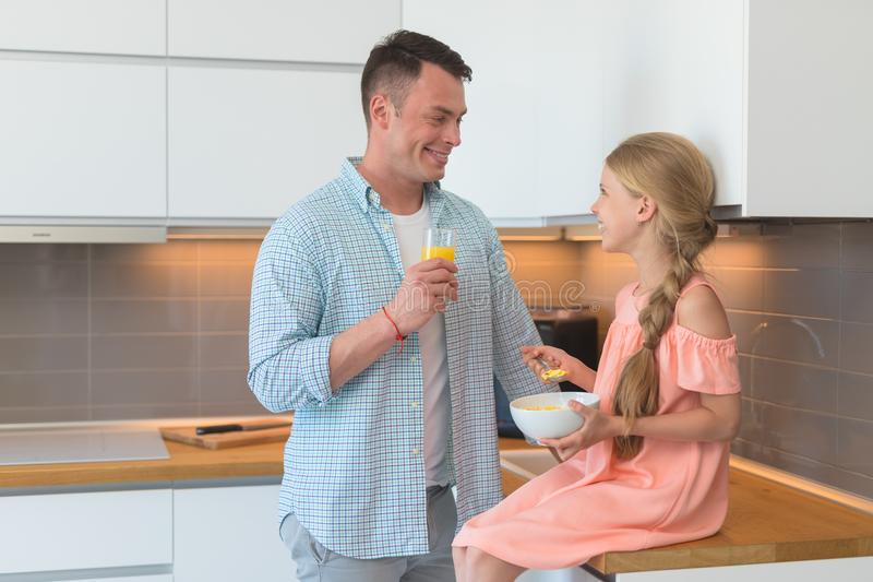 Young father and a little daughter have a breakfast royalty free stock photo