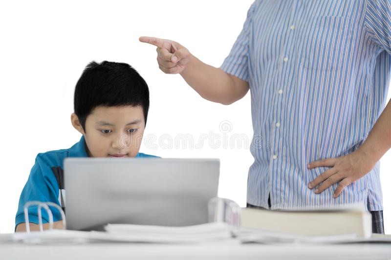Young father scolding his son on studio stock photography