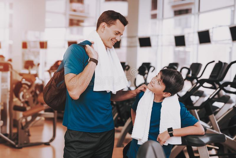 Young Father and Son near Treadmills in Modern Gym stock images