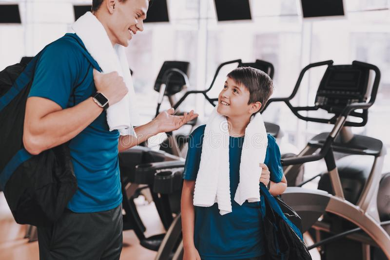 Young Father and Son near Treadmills in Modern Gym royalty free stock photography
