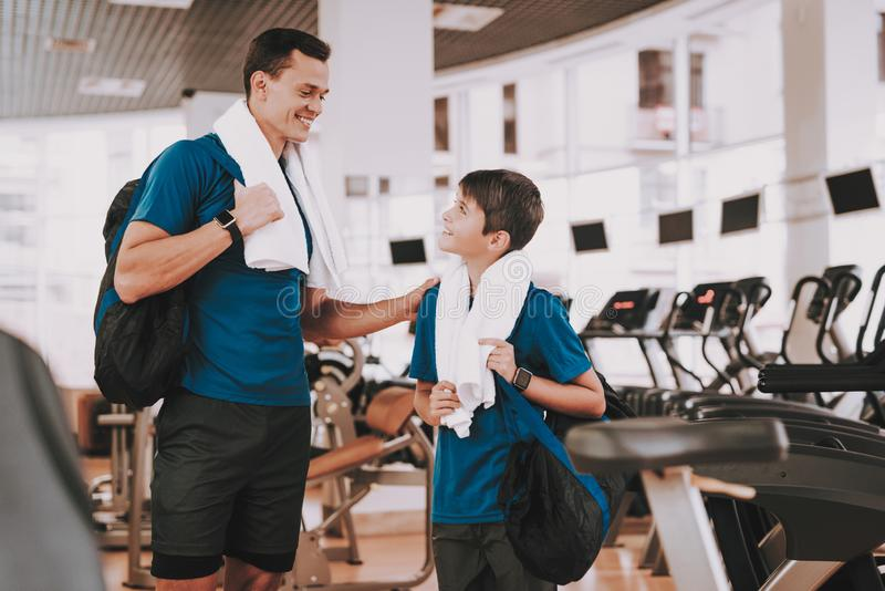 Young Father and Son near Treadmills in Modern Gym stock photo