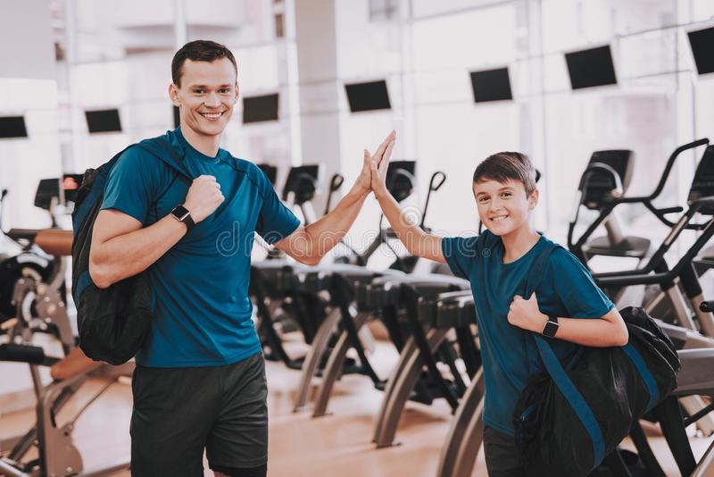 Young Father and Son near Treadmills in Modern Gym stock photography