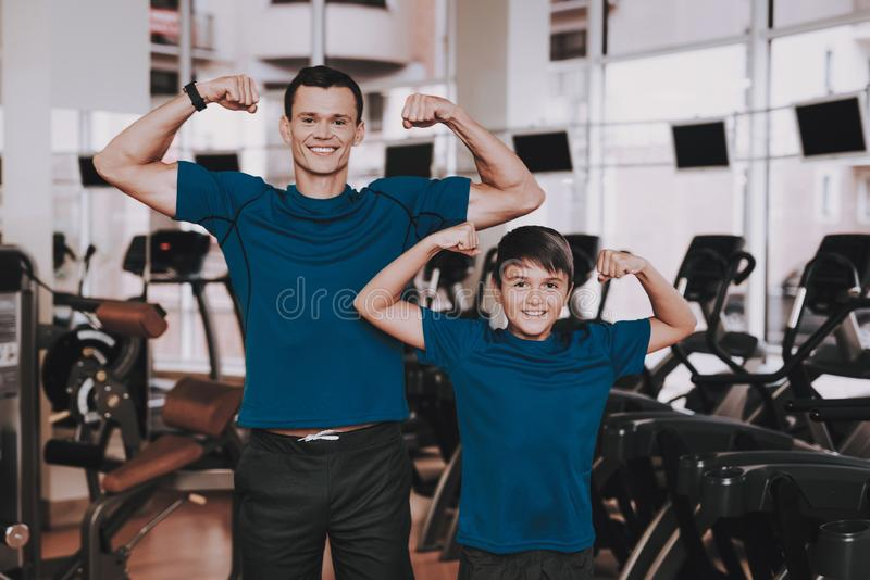 Young Father and Son Preparing for Training in Gym royalty free stock photography