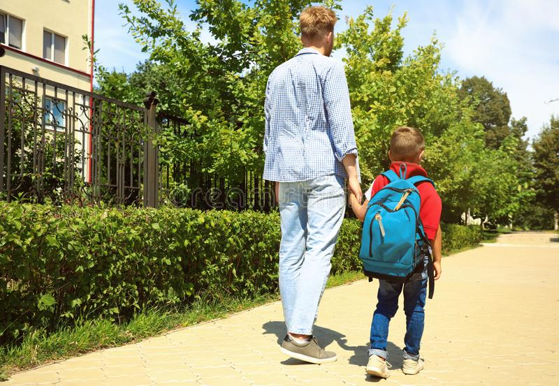 Young father taking his little child to school royalty free stock image