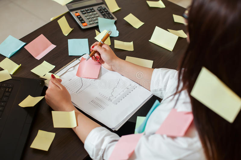Young female accountant manager at workplace royalty free stock images