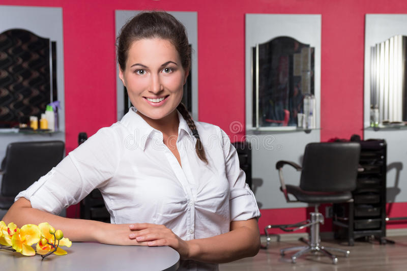 Young female administrator of beauty salon. Young beautiful female administrator of beauty salon stock images