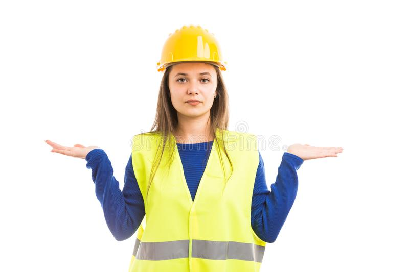 Young female architect holding alternatives. Young attractive female architect or woman engineer holding alternatives with hands as balance concept isolated on royalty free stock photography