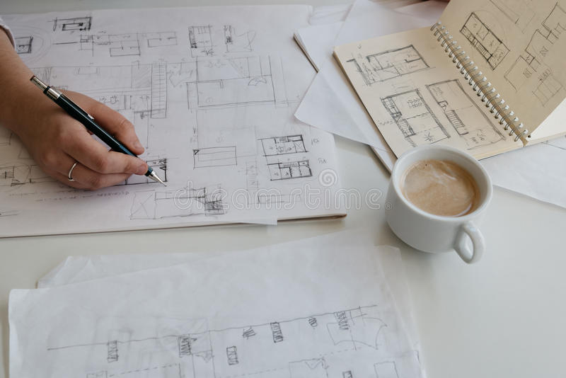 Young female architect working on sketches stock photography