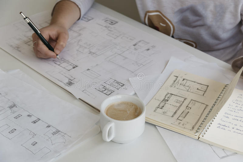 Young female architect working on sketches stock photos