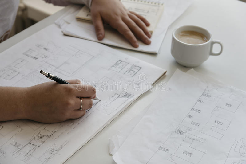Young female architect working on sketches royalty free stock photos