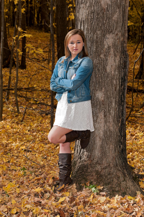 Young Female Arms Crossed Against Tree stock photo
