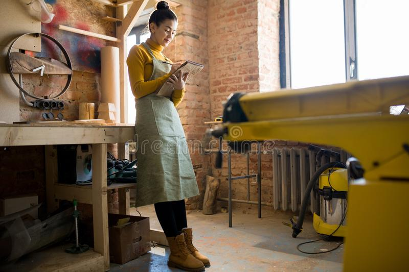 Young Female Artisan in Workshop stock photography